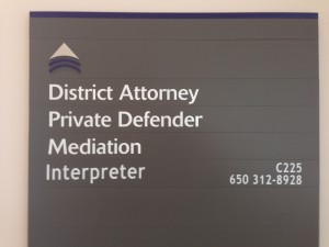 "A sign reading, ""District Attorney, Private Defender, Mediation, Interpreter"
