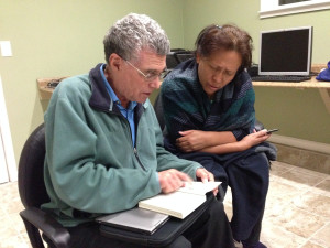 Silvia Ramirez (right) helps David Vallerga (left) with his Spanish at our monthly book group.