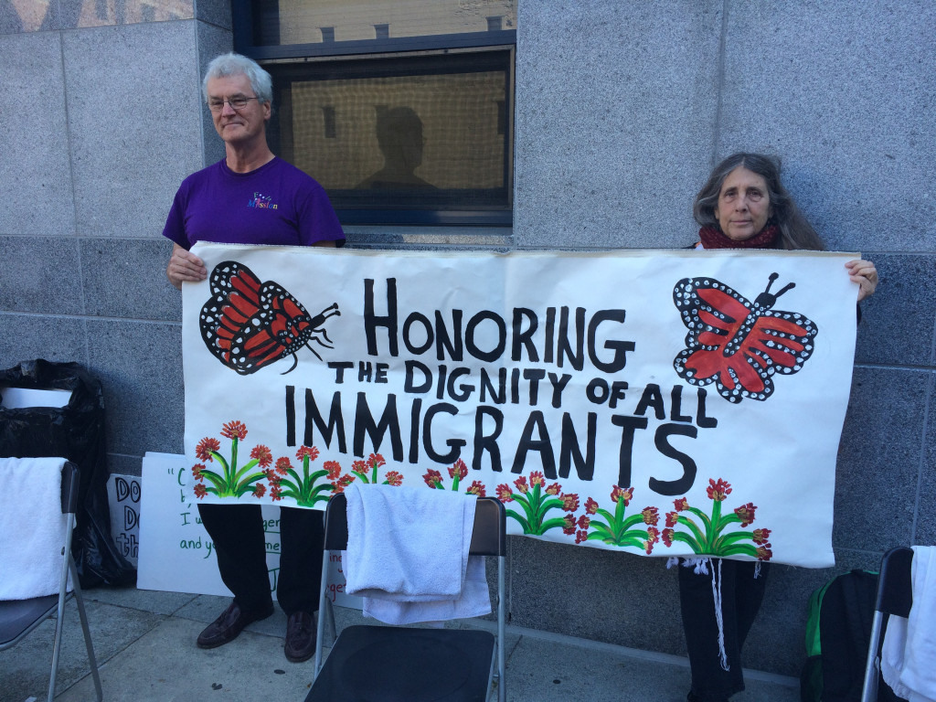 On Holy Thursday in 2015, Fools Mission joined IM4HI a demonstration outside the San Francisco headquarters of Immigration and Customs Enforcement (ICE), where we washed the feet of undocumented immigrants. Fool Thomas Atwood and Rabbi Lynn Gottlieb are flying the colors.